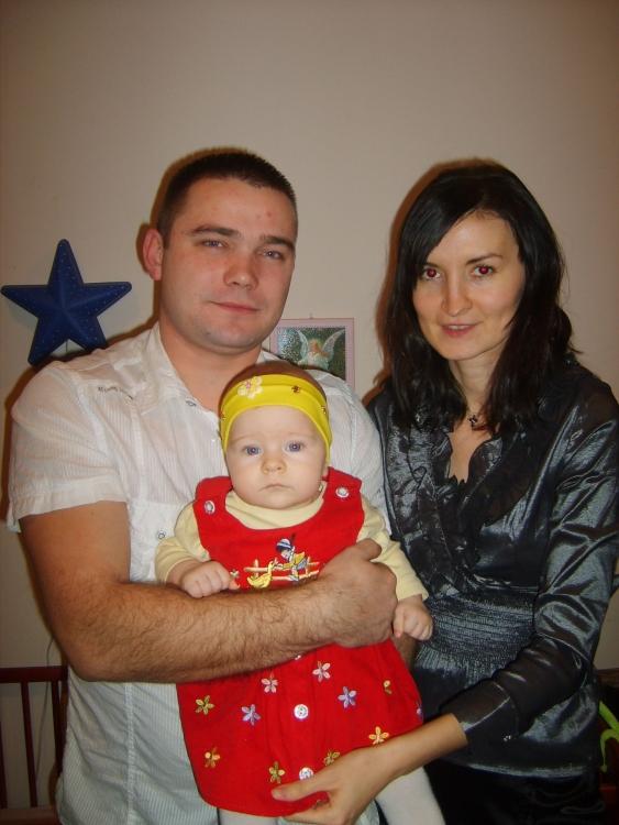 Den helbredete fru Roxana med sin mann og datter